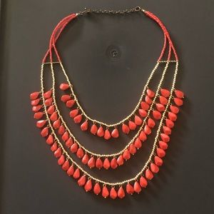 Coral Red Has A Statement Necklace